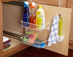 Rollout storage! Keep your cleaning supplies organized with this slideout storage panel. Mount drawer slides in the cabinet under your kitchen sink to support the sliding panel.
