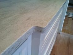 Martha Stewart Sea Salt Corian countertop  LOVE. Perfect if you are choosing white cabinets for your kitchen remodel.