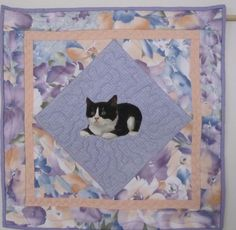 A personal favorite from my Etsy shop https://www.etsy.com/listing/178708329/quilted-and-appliqued-cat-table-center
