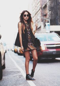 Boho kind of like maybe indian dress and the black vest with aviator shades and the booties ar total perfection