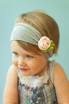Not a fan of those huge head bands for baby girls, but I do like this one. It doesn't look so big on baby