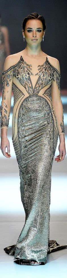 There's no feminine shape to this.  Even the illusion from the nude tone panels doesn't keep it from looking chunky. ~  Dany Tabet Spring-summer 2015.