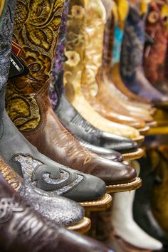 Colorful Boulet Cowboy Boots on a shelf. Boots and boots and more boots at the Denver Market via Horsesandheels.com