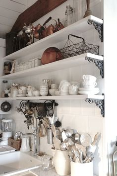 Open Shelving - in a rustic kitchen - via Love Your Homes: Every millimeter of the storage shelves