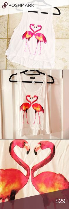 Cute Wila Flamingo Tank Adorable white Tanks with tropical pink flamingo print. Brand new with tags from Wila, and awesome wholesale portal brand. Soft, stretch fabric; 100% rayon. Loose fit. Wide-cut arm holes, would be perfect over a bralet. Perfect for summer! Get them while they last! 1 in each size S-L available currently. I don't have room to give measurements for each size here but if you need them please feel free to comment! Last 2 pics courtesy of @shopwila WILA Tops Tank Tops