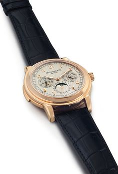 Patek Philippe Reference 5074  Estimated at $400,000 – $600,000, this #PatekPhilippe watch from 2007 went for $461,000 in Christie's December 2013 watch auction. It's a very complicated watch in a rose-gold case, featuring a minute repeater, perpetual calendar and moon-phase display.