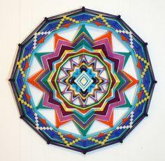 Colorful Life, a 24 inch Ojos de Dios by Jay Mohler