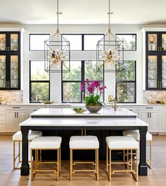 In a large stylish kitchen, two islands are better than one.