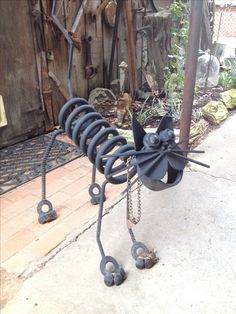 Welded Metal cat. I made this. Crook Cat made of car parts & scraps. From Rustic Repo