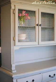 DIY: Dated Hutch Makeover - this lists what steps were taken and what products were used to update this 1990's hutch. Replacing the glass with chicken wire really adds to this piece!