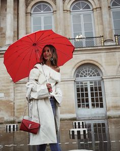 P A R I S under the rain. ❤️ Back in this beautiful city w my @revolve fam and friends, wearing @houseofharlow1960 top. #revolvearoundtheworld • PS how cute is my heart shaped umbrella? trop mignon!