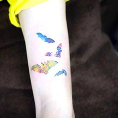 A nice tattoo of small colorful bats in different styles: spaces, nature and other. Color: Colorful. Tags: Nice, Awesome