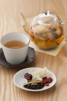 Ba bao cha (Chinese herbal tea)    A keemun tea base is blended with Chinese dates, wolfberries, dried tangerine peel, white fungus, green beans and rock sugar.