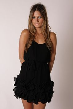 "This flirty LBD has just the right amount of ruffly flair with a ""come hither"" sex appeal."