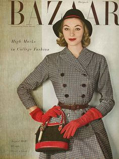 August Harper's Bazaar 1951    Model is wearing a double breasted checked dress made with pinwale corduroy by Henry Rosenfeld.