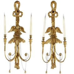 flanking the Poillerat mirror in dining area - A pair of Regency style giltwood wall lights