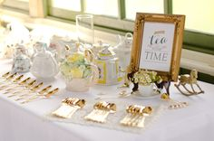 Beautiful tea station - perfect for bridal shower or intimate wedding reception. Vintage mix and match tea cups and gold cutlery.