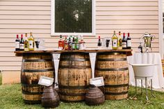 We love the idea of using whiskey barrels as cocktail tables, instead of using linens. I think this is another good way to incorporate whiskey barrels too!