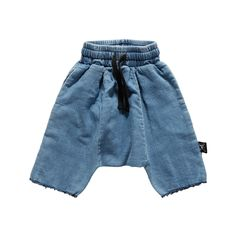 $60 Jeans french terry baggy shorts with an elastic waistband, black pull string, slanted pockets in side seam and a deconstructed raw hem. #nununu #denim #kidsstyle