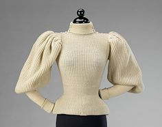This very early sportswear sweater combines the aesthetics of fashionable dress through its large gigot sleeves and overall silhouette with the informal sportiness inherent in any knit fabric.  Casual wear, such as this, is rare in museum collections because of the nature of its use and the intrinsic value people placed on more formal attire