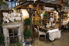 love the set-up in this shop or booth. Probably not feaslible for us, but it sure would look awesome at the craft show!
