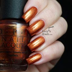 Lucy's Stash - OPI A Woman's Prague-ative - burnt orange/rusty brown foil with gold particles.