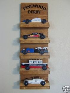 Cool stand for several years of pinewood derby.   This makes me think of those fun Scouting years with my son. fun to race with the guys