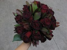 I wouldn't mind having a dark bouquet of red roses, though my dream is ALL 'black' roses.