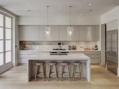 Modern Kitchen Interior Remodeling White kitchen with wood stools and marble countertop on island - One of our favorite places for marble is the kitchen, where it lends the space timeless appeal. Get ready to swoon over these modern marble kitchens. Kitchen Ikea, Kitchen Room Design, White Kitchen Cabinets, Home Decor Kitchen, Interior Design Kitchen, Kitchen White, Kitchen Modern, Modern Cabinets, Grey Cabinets