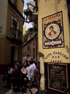 Sevilla, Barrio de Santa Cruz - bar de tapas.... in the mood for a city trip? http://www.costatropicalevents.com/en/cultural/city.html