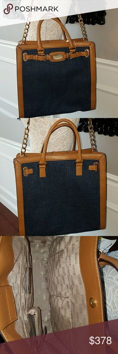 """NWT Michael Kors Hamilton indigo denim frame tote Authentic Sold out in stores and only one on posh!  Retail  $398  ⚠minor scuff at top of one handle- see photo-please do not buy if this is an issue for you .  Does not detract from this otherwise pristine bags beauty!  ⚠  Luggage acorn color saffiano leather trim. Gold tone hardware.Top handles; 4 3/4' drop.Frame top with MK logo-engraved detail.Inside, one zip pocket, three open pockets, and one cell pocket. Protective feet on bottom. 13""""H…"""