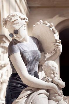 Creative photo series by photographer Léo Caillard features old statues dressed in hipster clothing.