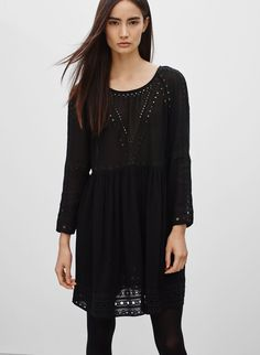 WILFRED LOISEL DRESS A loose-flowing silhouette with delicate embroidery, black or taupe