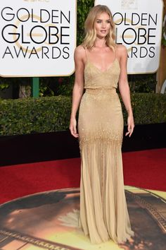 2016 Golden Globe Awards held at the Beverly Hilton Hotel on January 10 in Beverly Hills, California. Rosie Huntington-Whiteley was gorgeous in a custom-made, Atelier Versace fully beaded champagne gown with delicate slit made of ethereal chiffon.
