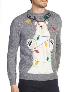Grey twist Christmas jumper featuting a polar bear who has partied a bit too hard!