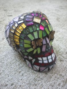 Dia De Los Muertos Mariposa Mosaic Stained Glass Skull - Day of the Dead Skull with Butterfly Eyes.