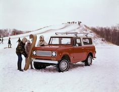 Color advertising photograph of a woman and two children with a toboggan and an International Scout pickup truck. A snow-covered sledding hill is in th. International Scout, International Harvester, Cool Trucks, Cool Cars, 4x4, Us Cars, Ford Bronco, Vintage Trucks, Plein Air