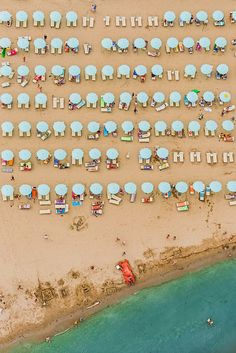 Aerial Views Adria is a collection of colorful photographs in which the sandy shores of Europe have been transformed into a series of abstract shapes and f