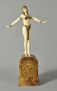 "Art Deco ""Syrian Dancer"" by Demetre Chiparus, a superb chryselephantine carved ivory figurine of a young woman in gilded and enameled bronze dancing costume raised on a brown onyx plinth with inset embossed bronze plaque"
