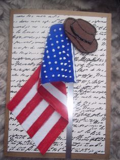 This is a card I made for a friend who wanted to welcome a friend to US citizenship. The post is made from aluminum, the flag is heavy cloth, marker & paint & the hat is made from felt using dimensional paint.