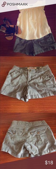 French Star girls shorts gray size 8 adjustable French Star girls shorts purchased at Nordstrom Rack.  Size 8 with adjustable waistband. Slit side pockets and patch pockets on back. Zipper and button closure. French Star Bottoms Shorts