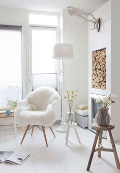 Shades of white, and a cozy touch with a faux fur throw.