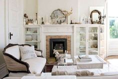 Victorian White Room:      The pale palette offered by Polar Bear-painted walls from Kelly puts this living room's romantic arc... - Provided by Country Living