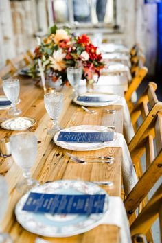 vintage plates and navy menus wedding tablescape