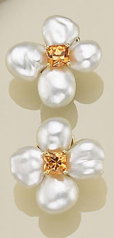 A pair of South Sea Keshi cultured pearl, mandarin garnet and eighteen karat gold earrings, Donna Vock