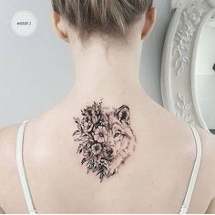 25 Back Tattoo Ideas For Women That Are Simply Wow! Wolf floral black and white tattoo design idea inspiration animal beast tattoo