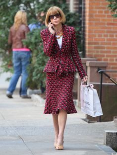 Anna Wintour (age 63) spotted wearing a tweed Oscar de la Renta suite after doing some shopping at Chanel in New York