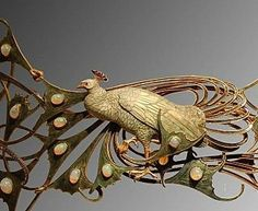 René Lalique - closeup of peacock hair clip