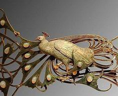 René Lalique - closeup of peacock hair clip