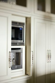 Hide the microwave. This is an interesting idea. Recess the microwave in a bit and put a sliding cabinet door over it.. but where would it slide to?